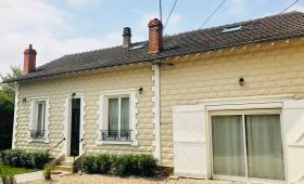 Maison rénovée, façade ravalée et allée rénovée